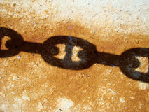 Links shadow. Old rusty iron chain links shadow Royalty Free Stock Image