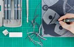Lino cutting in art class close up. Lino cutting tools on a desktop. Lino cutting in arrt class Royalty Free Stock Image