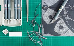 Lino cutting tools on table. Lino cutting tools on a desktop. Flat lay view of lino cut tools Royalty Free Stock Photos