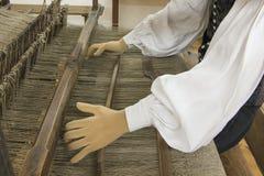 Lino que teje, arte tradicional Foto de archivo