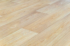 Linoleum flooring with embossed light wood texture close-up. Horizontal layout perspective. Limited depth of field stock photography