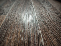Linoleum flooring with embossed wood texture close-up Stock Images