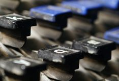 Linotype keyboard letters k, q keys closeup Royalty Free Stock Photography