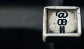 Linotype keyboard letters oe, h white keys closeup with space stock photos