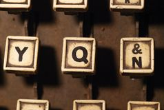 Linotype keyboard letters y, q, n keys closeup Royalty Free Stock Images
