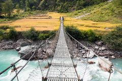 Linowy wiszący zawieszenie most w Nepal zdjęcia royalty free