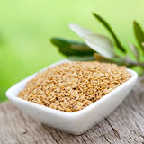 Linseed. In a bowl on wooden ground Royalty Free Stock Photos