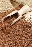 Linseed, flax seeds, wooden scoop, sack Royalty Free Stock Photography