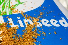 Linseed grain on a paper sack Royalty Free Stock Photos