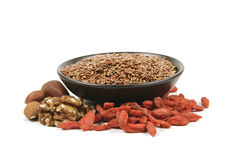 Linseed In A Bowl With Nuts And Goji Berries Royalty Free Stock Images