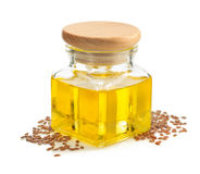 Linseed oil in bottle isolated on white Royalty Free Stock Photography