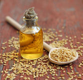 Linseed oil in bottle on wooden background Stock Photography