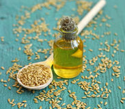 Linseed oil in bottle on wooden background Stock Photo