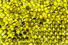 Linseed oil in bright yellow capsules contour light Selective focus royalty free stock images