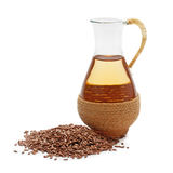Linseed oil with flax seeds stock photo