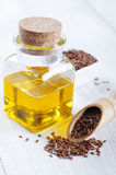 Linseed oil and flax seeds Stock Image