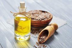 Linseed oil and flax seeds Royalty Free Stock Photo