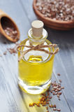 Linseed oil. And flax seeds on wooden background Royalty Free Stock Photography