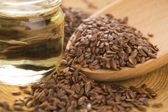 Linseed oil and flax seeds Royalty Free Stock Image