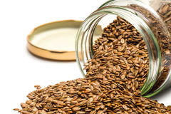 Linseed in an overturned glass jar Stock Photos