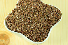 Linseed in a white bowl Stock Image