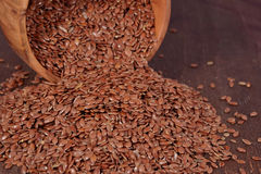Linseed in a wooden bowl Stock Images