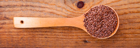 Linseed on a wooden spoon Royalty Free Stock Image