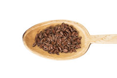 Linseed on a wooden spoon Stock Image