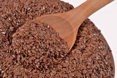 Linseed in a wooden spoon Stock Photos