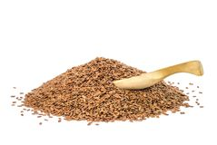 Linseeds with wooden spoon Stock Photo