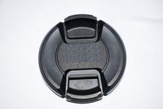 Linsenkappe lokalisiert auf weißer Hintergrundschwarzfarbe 18-55mm 52mm Stockfoto