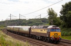 Pullman excursion diesel express. LINSLADE, UK - JUNE 26: A vintage class 57 diesel locomotive, Northern Princess, hauls a luxury Pullman passenger express Stock Photos