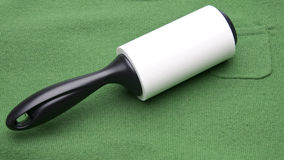 Lint Roller on a Green Sweater Royalty Free Stock Image