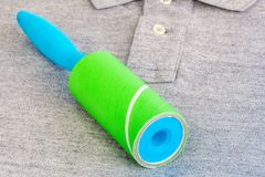 Lint roller on polo shirt close up Stock Photos