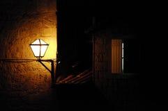 Linterna cerca de la ventana Fotos de archivo libres de regalías