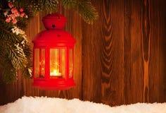 Linterna de la vela de la Navidad en árbol de abeto Fotos de archivo libres de regalías