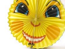 Linterna de papel en la dimensión de una variable de una cara sonriente divertida Imagen de archivo
