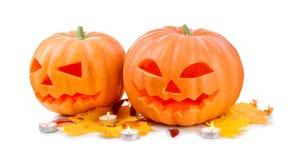 Linterna del enchufe de la cabeza de la calabaza de Halloween con las velas ardientes Fotos de archivo libres de regalías