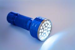 Linterna llevada azul encendida Foto de archivo libre de regalías