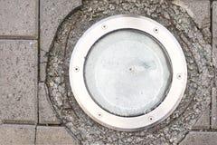 Linterna redonda en la tierra Azulejos grises fotografía de archivo libre de regalías