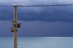 Linterna y mar de la calle Fotografía de archivo libre de regalías
