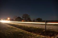Linternas en la conducción oscura Imagenes de archivo