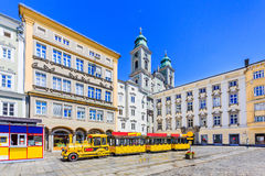 Linz, Austria. Old Cathedral & x28;Alter Dom& x29; and tourist train in the Main Square & x28;Hauptplatz& x29 Stock Images