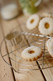 Linz biscuit with peach marmalade with a glass of milk in the ba Stock Images