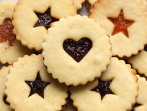 Linzer cookies. (Austrian specialty) with red currant and apricot jam royalty free stock images