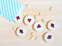Linzer cookies with cherry jam on the table Royalty Free Stock Images