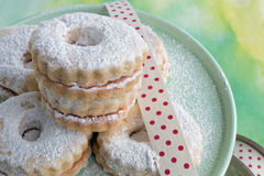 Linzer cookies on plate. Close up of Linzer cookies on plate studio shot Stock Images