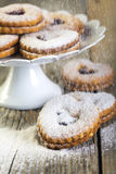 Linzer cookies sprinkled with powdered sugar. Royalty Free Stock Photo