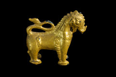 Lion ancient statue - Golden lion statue in Thai style with isol Stock Photo