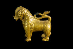 Lion ancient statue - Golden lion statue in Thai style with isol Royalty Free Stock Image